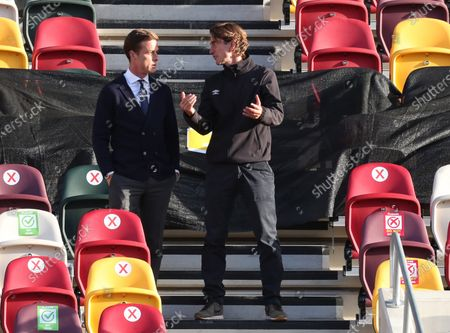 Managers Scott Parker , of Fulham (left) and Thomas Frank of Brentford talk before the game