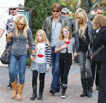 Stock Picture of Emily Grace Reaves (tee-shirt with red lips on), Billy Ray Cyrus with daughter Noah Cyrus and wife Tish Cyrus
