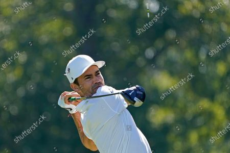 Camilo Villegas of Colombia watches his drive from the ninth tee during the first round of the Sanderson Farms Championship golf tournament in Jackson, Miss