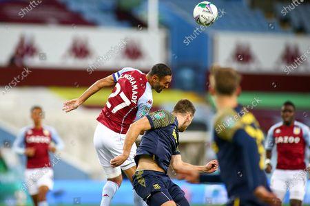 Ahmed Elmohamady of Aston Villa (27) wins a header during the EFL Cup match between Aston Villa and Stoke City at Villa Park, Birmingham