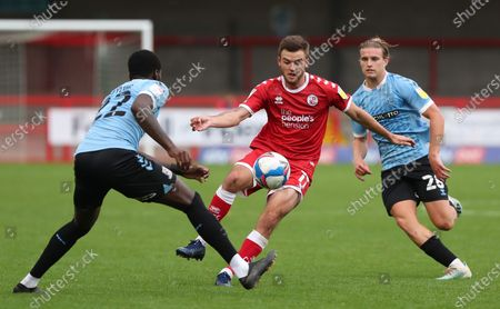 Crawley Town's Tyler Frostvies for the ball against  Southend's Richard Taylor during the Sky Bet League Two match between Crawley Town and Southend United at the People's Pension Stadium in Crawley . 03 October 2020