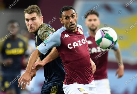 Stoke City's Sam Vokes, left, and Aston Villa's Ahmed Elmohamady challenge for the ball during the EFL Cup 4th round soccer match between Aston Villa and Stoke City at the Villa Park stadium in Birmingham, England