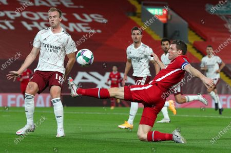 Liverpool's James Milner reaches out for the ball during the English League Cup fourth round soccer match between Liverpool and Arsenal at Anfield, Liverpool, England