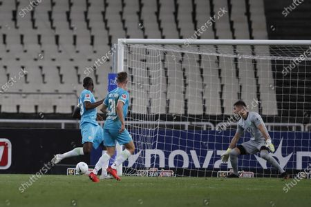 AEK's Karim Ansarifard scores his side's second goal during the Europa League playoff soccer match between AEK Athens and VfL Wolfsburg at the Olympic stadium in Athens, . AEK Athens won 2-1