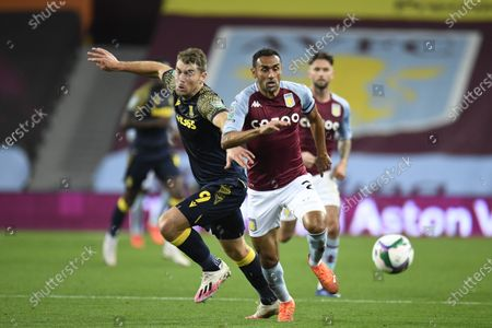 Sam Vokes (L) of Stoke City and Ahmed El Mohamady (R) of Aston Villa in action during the English Carabao Cup 4th round soccer match between Aston Villa and Stoke City in Birmingham, Britain, 01 October 2020.
