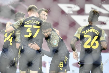 Sam Vokes (back C) of Stoke City celebrates with teammates after scoring the 1-0 lead during the English Carabao Cup 4th round soccer match between Aston Villa and Stoke City in Birmingham, Britain, 01 October 2020.