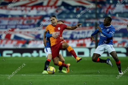 Galatasaray's Radamel Falcao competes for the ball with Rangers' Steven Davis, left, and Rangers' Glen Kamara, right, during the Europa League qualifying play-off soccer match between Rangers and Galatasaray at Ibrox Stadium, in Glasgow, Scotland