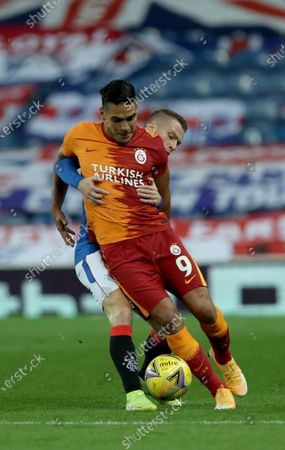 Galatasaray's Radamel Falcao, 9, competes for the ball with Rangers' Steven Davis during the Europa League qualifying play-off soccer match between Rangers and Galatasaray at Ibrox Stadium, in Glasgow, Scotland