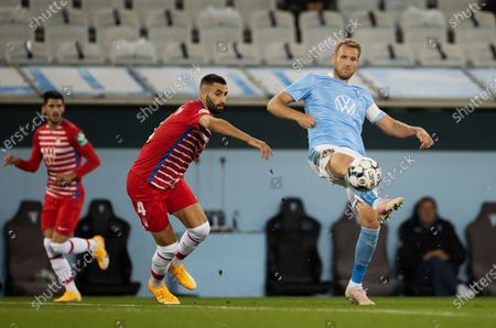 Stock Photo of Granada's Maxime Gonalons (L) and Malmo's  Ola Toivonen in action during the UEFA Europa League playoff soccer match between Malmo FF and Granada CF at Malmo New Stadium in Malmo, Sweden, 01 October 2020.