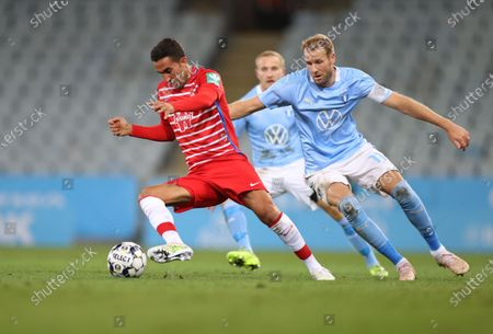 Granada's Angel Montoro Sanchez (L) and Malmo's Ola Toivonen in action during the UEFA Europa League playoff soccer match between Malmo FF and Granada CF at Malmo New Stadium in Malmo, Sweden, 01 October 2020.