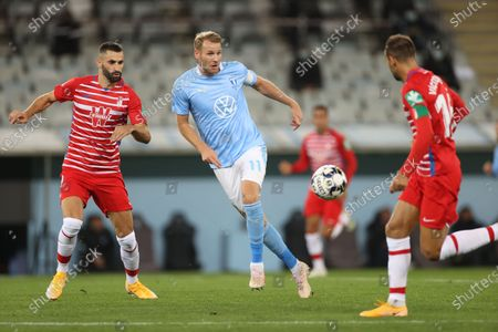 Stock Image of Granadas´s Maxime Gonalons and Malmo´s Ola Toivonen during the UEFA Europa League play-off soccer match between Malmo FF and Granada CF at Malmo New Stadium