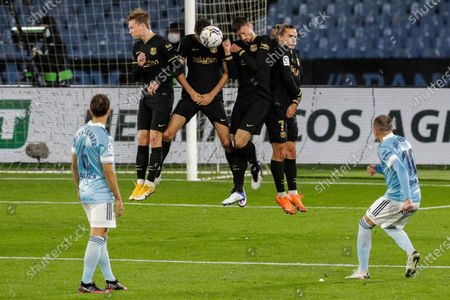 Celta Vigo's Iago Aspas shoots a free kick during the Spanish La Liga soccer match between RC Celta and FC Barcelona in Vigo, Spain