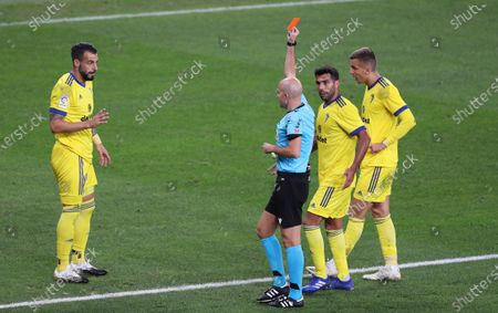 Cadiz's striker Alvaro Negredo (L) is sent off with a red card by referee Gonzalez Fuertes (C) during a Spanish LaLiga soccer match between Athletic Bilbao and Cadiz at San Mames stadium in Bilbao, Spain, 01 October 2020.