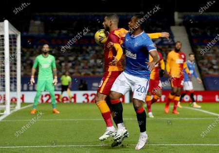 Alfredo Morelos (R) of Rangers in action against Younes Belhanda (L) of Galatasaray during the UEFA Europa League playoff soccer match between Glasgow Rangers and Galatasaray Istanbul in Glasgow, Britain, 01 October 2020.