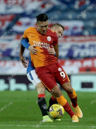 Steven Davis (back) of Rangers in action against Radamel Falcao (front) of Galatasaray  during the UEFA Europa League playoff soccer match between Glasgow Rangers and Galatasaray Istanbul in Glasgow, Britain, 01 October 2020.