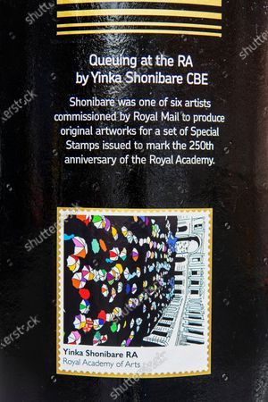 Stock Picture of A Royal Mail postbox from the time of King George VI reign in Brixton, South London has been painted as part of Black History Month in October. It is one of four to have been painted others are in Glasgow, Belfast, & Cardiff. It features 'Queuing at the RA' by British-Nigerian artist Yinka Shonibare, one of six artists who were commissioned by the Royal Mail to produce original artworks for a set of special stamps issued to mark the 250th anniversary of the Royal Academy (RA).
