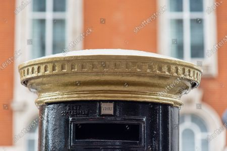 A Royal Mail postbox from the time of King George VI reign in Brixton, South London has been painted as part of Black History Month in October. It is one of four to have been painted others are in Glasgow, Belfast, & Cardiff. It features 'Queuing at the RA' by British-Nigerian artist Yinka Shonibare, one of six artists who were commissioned by the Royal Mail to produce original artworks for a set of special stamps issued to mark the 250th anniversary of the Royal Academy (RA).