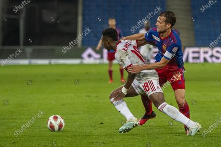 Valentin Stocker (R) from Basel and Bradley Mazikou (L) from Sofia in action during the UEFA Europa League playoff soccer match between the FC Basel and CSKA Sofia at the St. Jakob Park Stadium in Basel, Switzerland, 01 October 2020.