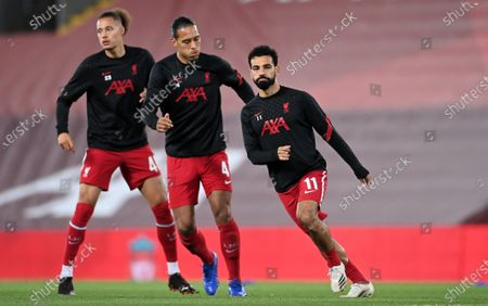 Liverpool players (L-R) Rhys Williams, Virgil van Dijk, and Mohamed Salah warm up for the English Carabao Cup 4th round soccer match between Liverpool FC and Arsenal FC in Liverpool, Britain, 01 October 2020.