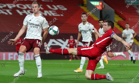 Arsenal's Rob Holding (L) in action against Liverpool's James Milner (R) during the English Carabao Cup 4th round soccer match between Liverpool FC and Arsenal FC in Liverpool, Britain, 01 October 2020.