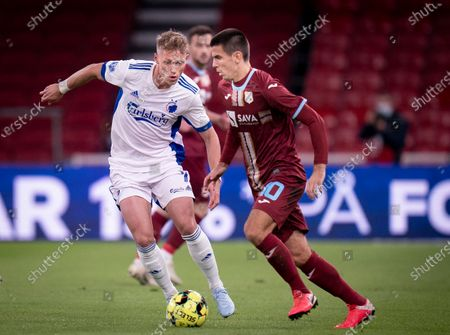 Copenhagen's Viktor Fischer (L) and HNK Rijeka's Domagoj Pavicic in action during the UEFA Europa League playoff match between FC Copenhagen and HNK Rijeka in Copenhagen, Denmark, 01 October 2020.