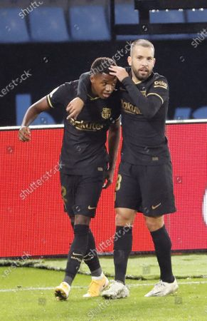 Stock Picture of FC Barcelona's Ansu Fati (L) celebrates with teammate Jordi Alba after scoring  the 0-1 lead goal during a Spanish LaLiga soccer match between Celta de Vigo and FC Barcelona at Balaidos stadium in Vigo, northern Spain, 01 October 2020.