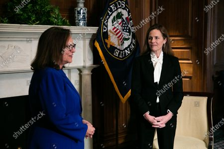 Judge Amy Coney Barrett, President Donald Trump's nominee for the US Supreme Court, looks on during a meeting with Senator Deb Fischer (L) (R - NE) at the US Capitol in Washington, DC, USA, 01 October 2020.