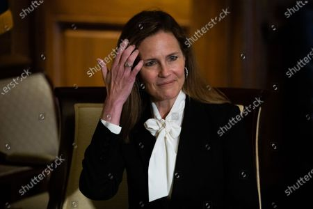 Judge Amy Coney Barrett, President Donald Trump's nominee for the US Supreme Court, looks on during a meeting with Senator Deb Fischer (not pictured) (R - NE) at the US Capitol in Washington, DC, USA, 01 October 2020.