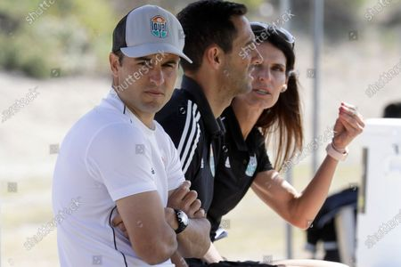 San Diego Loyal coach Landon Donovan, left, sits next to assistant coaches Nate Miller, center, and Carrie Taylor during a scrimmage in Chula Vista, Calif. Just before halftime, and with San Diego leading 3-1, Donovan's expansion Loyal walked off the field and forfeited their USL second division match after openly gay midfielder Collin Martin allegedly was called a homophobic slur by a Phoenix player