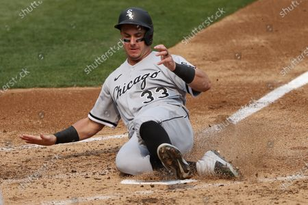 Chicago White Sox pinch-runner James McCann slides safely into home plate while beating a play against the Oakland Athletics off Chicago White Sox Luis Roberts RBI double during the third inning of the American League Wild Card Series playoff game three at the Oakland Coliseum in Oakland, California, USA, 01 October 2020.
