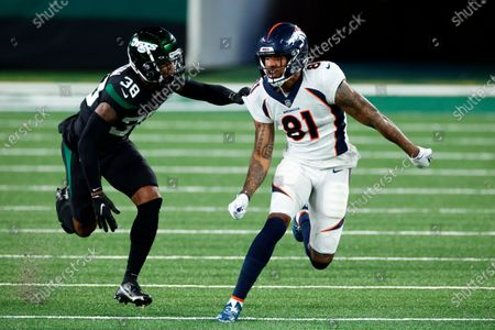 Denver Broncos wide receiver Tim Patrick (81) in action against New York Jets cornerback Lamar Jackson (38) during an NFL football game, in East Rutherford, N.J