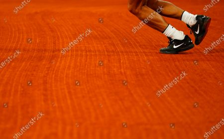 Rafa Nadal Nike tennis shoes on the clay court