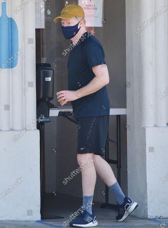 Jesse Tyler Ferguson sanitizes his hands before entering his car