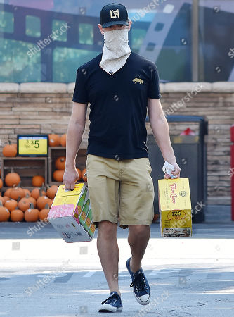 Stock Image of Colin Hanks buying refreshments