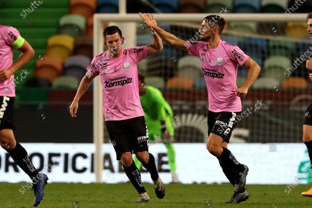 Peter Michorl (L) of LASK celebrates with James Holland during the UEFA Europa League play-off match between Sporting CP and LASK in Lisbon, Portugal, on Oct. 1, 2020.