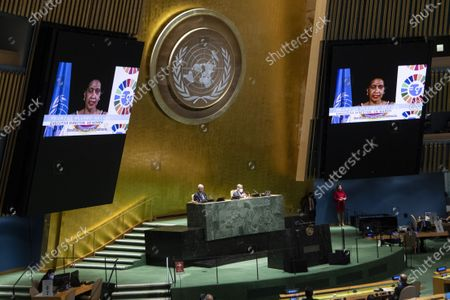 UN undersecretary-general and executive director of UN Women Phumzile Mlambo-Ngcuka (on the screens) addresses a high-level meeting on the 25th Anniversary of the Fourth World Conference on Women at the United Nations headquarters in New York, on Oct. 1, 2020. United Nations Secretary-General Antonio Guterres on Thursday urged member states to make concrete, time-bound and ambitious commitments to women's leadership and full participation.