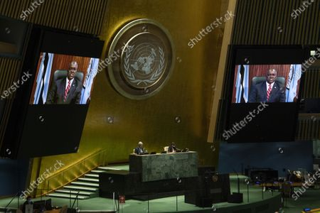 Botswanan President Mokgweetsi Masisi (on the screens) addresses a high-level meeting on the 25th Anniversary of the Fourth World Conference on Women at the United Nations headquarters in New York, on Oct. 1, 2020.