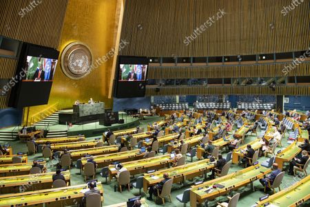 Stock Photo of South African President Cyril Ramaphosa (on the screens) addresses a high-level meeting on the 25th Anniversary of the Fourth World Conference on Women at the United Nations headquarters in New York, on Oct. 1, 2020.