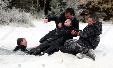 Victoria Sugden [Isobel Hodgins] Warns Daz Eden [Luke Tittenshaw] That the Ice He's Standing on is Breaking.  She Runs on to Stop Him and Ice Breaks Swallowing Her Up.  Daz Jumps in to Save Her as Jake Doland [James Baxter], Scarlett Nicholls [Kelsey-Beth Crossley] and Aaron Livesy [Danny Miller] Look on.