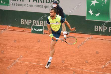 Stock Picture of Laslo Djere at Roland Garros stadium