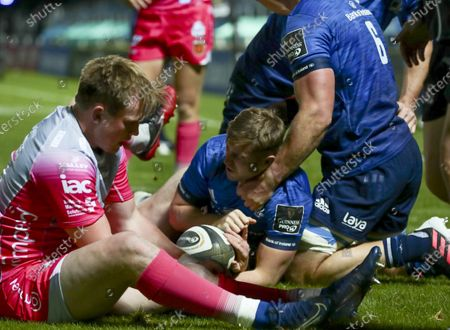 Stock Photo of Jordan Larmour (Leinster) scores a try despite the tackle by Sam Davies (Dragons); RDS Arena, Dublin, Leinster, Ireland; Guinness Pro 14 Rugby, Leinster versus Dragons.
