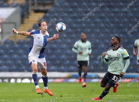 Lewis Holtby of Blackburn Rovers control the ball with his chest as Junior Hoilett of Cardiff City looks on; Ewood Park, Blackburn, Lancashire, England; English Football League Championship Football, Blackburn Rovers versus Cardiff City.