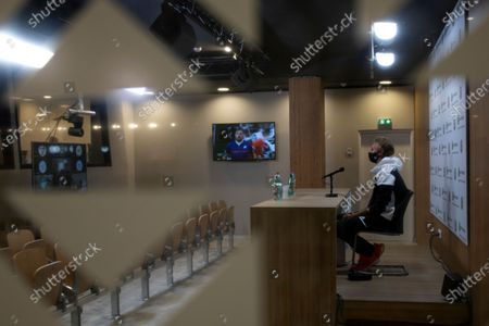 Sebastian Korda of the U.S. answers questions of journalists during a video link press conference after his third round match of the French Open tennis tournament against Spain's Pedro Martinez at the Roland Garros stadium in Paris, France