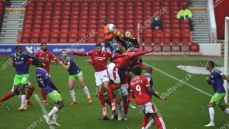 David Bentley punches clear in a crowded penalty area during the SkyBet Championship game between Nottingham Forest and Bristol City.