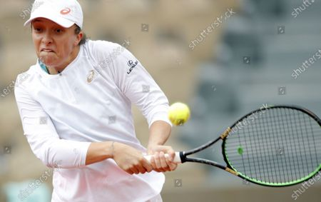 Iga Swiatek of Poland in action against Eugenie Bouchard of Canada during their women's second round match during the French Open tennis tournament at Roland Garros in Paris, France, 02 October 2020.