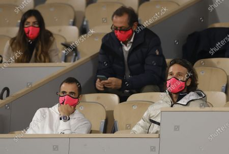 Stock Photo of Carlos Moya (bottom R), coach of Rafael Nadal of Spain, watches Nadal in his third round match against Stefano Travaglia of Italy at the French Open tennis tournament at Roland Garros in Paris, France, 02 October 2020.