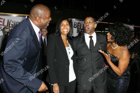 Stock Picture of Magic Johnson, Cookie Johnson, Denzel Washington and Paulette Washington