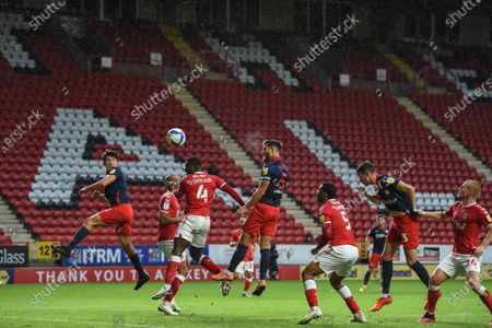 Bailey Wright (5) of Sunderland FC rises to head the ball but Ben Amos (13) of Charlton Athletic saves