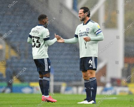 Junior Hoilett (33) of Cardiff City shakes hands with Sean Morrison (4) of Cardiff City before the game