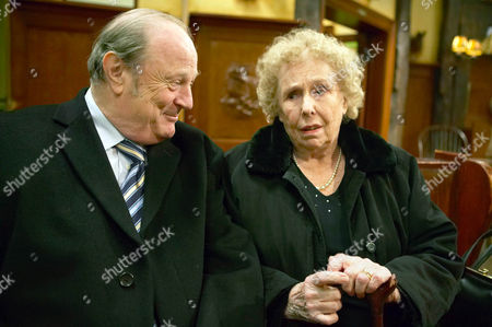 Stock Image of Annie Sugden [Sheila Mercier] Arrives From Spain.  Alan Turner [Richard Thorp] This is Really a Previous Scene But There is More Family in This Scene.